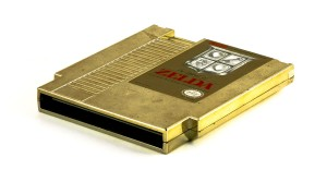 The Legend of Zelda NES Cartridge By Dave or Atox (2008 Leftovers: Zelda Gold Cart) [CC BY 2.0], via Wikimedia Commons